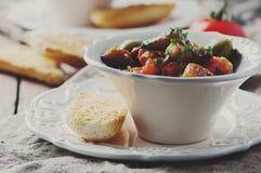 Traditional sicilian dish caponata with eggplant and tomato Stock Image