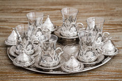 Traditional Silver Coffee Cup Set in a Tray on Wooden Background Royalty Free Stock Photo