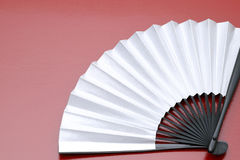 Traditional silver folding fan Stock Image