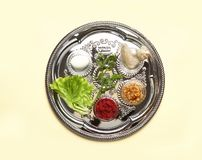 Traditional silver plate with symbolic meal for Passover Pesach Seder on color background stock photos