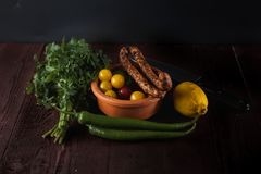 Traditional simple meal setup with meat and vegetables. And lemon Royalty Free Stock Image