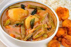 Traditional Sindhi meal -sindhi kadhi and rice. Sindhi kadhi is made up of gram flour and vegetables.It is served with fried taro and potatoes along with rice stock photos