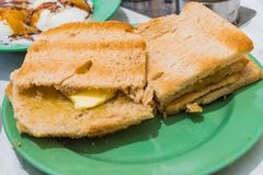 Singapore Breakfast Kaya Toast, Coffee bread and Half-boiled egg. Traditional Singapore Breakfast called Kaya Toast, Bread with Coconut Jam and Half-boiled eggs Royalty Free Stock Images