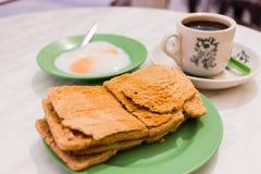 Traditional Singapore Breakfast called Kaya Toast, Crispy Bread. Traditional Singapore Breakfast called Kaya Toast, Oriental Chinese coffee in vintage mug and Stock Images