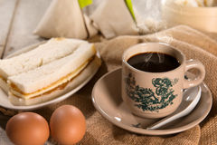 Traditional Singaporean Chinese dark coffee and breakfast Royalty Free Stock Photography