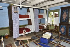 Traditional Sleeping Room in the Open-Air Village Museum near Kastelholm Castle, Sund, Aland, Finland. Royalty Free Stock Photo