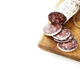 Traditional sliced meat sausage salami on wooden board Royalty Free Stock Photography