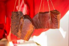 Traditional Slovak Smoked Bacon Slanina Hanging From the Top royalty free stock photo
