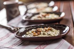 Traditional slovakian food Halusky with fried bacon and decorati Royalty Free Stock Photo