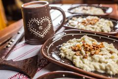 Traditional slovakian food Halusky with fried bacon and decorati Royalty Free Stock Image