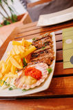 Traditional slovenian cuisine, meat kebab - chevapchichi - with french fries. Selective focus Stock Photography