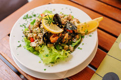 Traditional slovenian cuisine, seafood salad with fresh mussels, selective focus Stock Image