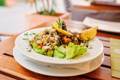Traditional slovenian cuisine, seafood salad with fresh mussels, selective focus Royalty Free Stock Photos