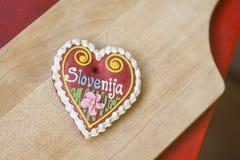 Traditional Slovenian gingerbread heart named LECT. Traditional Slovenian gingerbread heart with Slovenia written on it. Named LECTOVO SRČEK in Slovenian Stock Photo