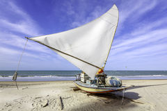 Traditional small fishing boat on the beach of Fortaleza. Brazil Royalty Free Stock Image