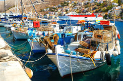 Traditional small fishing boats docked in main port of Symi island in Greece Stock Image