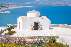 Traditional little whitewash Greek Orthodox Chapel on the edge of Aegean sea. Greece. Europe. Traditional small whitewash Greek Orthodox Chapel on the edge of royalty free stock image