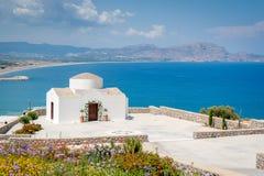 Traditional little whitewash Greek Orthodox Chapel on the edge of Aegean sea. Greece. Europe. Traditional small whitewash Greek Orthodox Chapel on the edge of royalty free stock photos