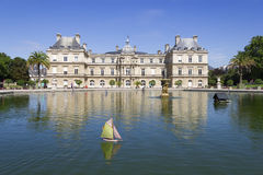 Traditional small wooden sailing boat in the pond of park Jardin. Du Luxembourg, Paris, France Royalty Free Stock Images