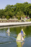 Traditional small wooden sailing boat in the pond of park Jardin Royalty Free Stock Image