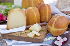 Traditional smoked cheese still life. Stock Images