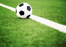 Soccer ball on grass field Royalty Free Stock Photo