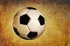 Traditional soccer ball on grunge textured background. A black and white traditional soccer ball on a grunge textured background Royalty Free Stock Photography
