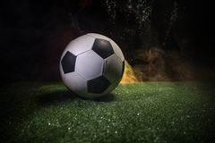 Free Traditional Soccer Ball On Soccer Field. Close Up View Of Soccer Ball (football) On Green Grass With Dark Toned Foggy Background. Stock Photos - 118611163