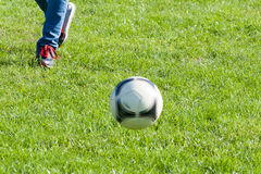 Traditional soccer ball on soccer field Royalty Free Stock Photography