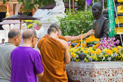 The traditional Songkran festival at pour water onto Buddha imag Royalty Free Stock Photography
