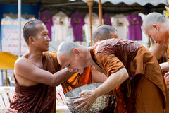 The traditional Songkran festival at pour water onto Buddha imag Stock Image