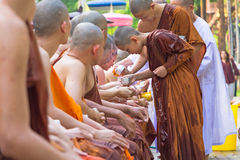 The traditional Songkran festival at pour water onto Buddha imag Stock Images
