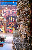 Traditional Souk market, Marrakech. Traditional Souks in the Medina of Marrakech with products and crafts of Morocco.  Metal and copper teapots, cups and Royalty Free Stock Image
