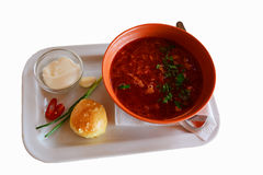 Traditional soup. Borsch - traditional Ukrainian vegetable soup served with sourr cream, garlic bread, greenery, hot pepper and garlic Stock Photos