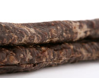 Traditional South African droewors. Made from either beef, buck, sprinbok, kudo, ostritch or game, macro closeup, isolated on white Royalty Free Stock Photography