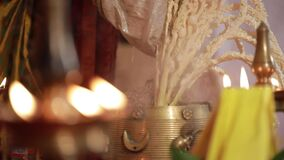 Traditional south indian ceramic oil lamp, Nilavilakku, on wedding ceremony,Nilavilakku is lighted before starting the rituals.