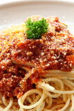 Traditional Spaghetti. Topped with beef sauce and parmesan cheese Royalty Free Stock Photos