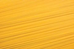 Traditional spaghetti pasta closeup background Texture, large detailed horizontal macro. Traditional spaghetti pasta closeup background Texture large detailed Royalty Free Stock Photos
