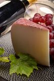 Traditional Spanish cheese, Murcian wine cheese from goat milk w. Traditional Spanish cheese, one piece of Murcian wine cheese from goat milk with rind washed in stock photo