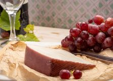 Traditional Spanish cheese, Murcian wine cheese from goat milk w. Traditional Spanish cheese, one piece of Murcian wine cheese from goat milk with rind washed in royalty free stock image