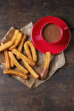 Traditional spanish churros with chocolate Royalty Free Stock Images