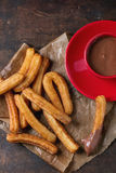 Traditional spanish churros with chocolate Royalty Free Stock Photo