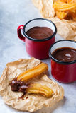 Traditional spanish churros with hot chocolate in a mug Royalty Free Stock Photo