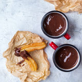 Traditional spanish churros with hot chocolate in a mug Royalty Free Stock Photos