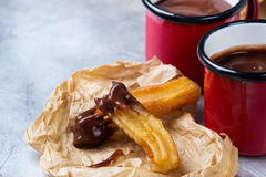 Traditional spanish churros with hot chocolate in a mug Stock Photography