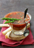 Traditional Spanish cold tomato soup gazpacho with green asparagus Stock Photos