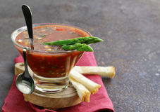 Traditional Spanish cold tomato soup gazpacho with green asparagus Stock Photo
