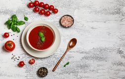Traditional Spanish cold tomato soup gazpacho in a white bowl on a dark stone background. Traditional Spanish food. Concept of Spa. Nish cold soup made of ripe stock image