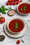 Traditional Spanish cold tomato soup gazpacho in a white bowl on a dark stone background. Traditional Spanish food. Concept of Spa. Nish cold soup made of ripe stock photo