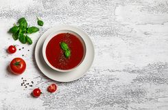 Traditional Spanish cold tomato soup gazpacho in a white bowl on a dark stone background. Traditional Spanish food. Concept of Spa. Nish cold soup made of ripe stock images